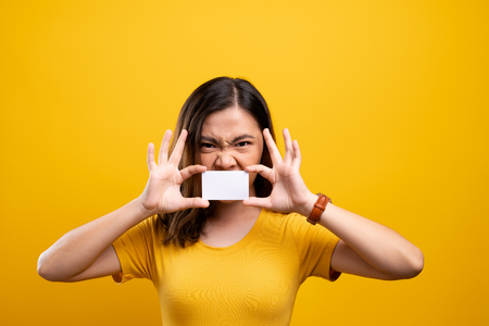 Angry woman covering face with paper card