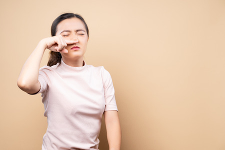 Woman wipe her nose and standing isolated over