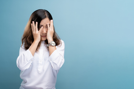 Woman feel scared standing isolated over blue background