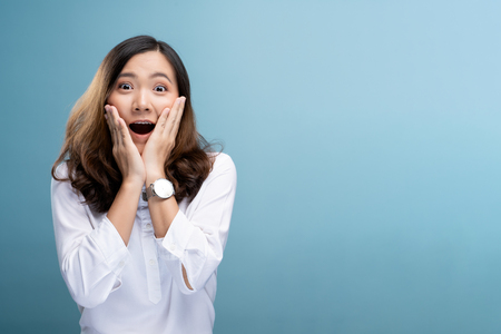 Portrait of excited woman isolated over background 스톡 콘텐츠