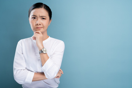 Woman feel confused isolated over blue background