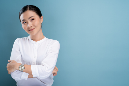 Portrait of a confident woman standing isolated over background