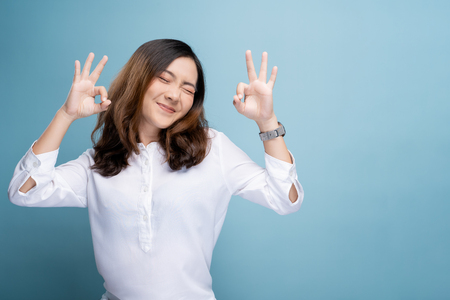 Happy woman showing OK gesture isolated on background Stok Fotoğraf - 122044311