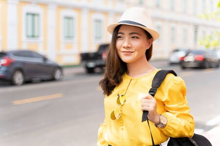 Happy woman traveling in Thailand