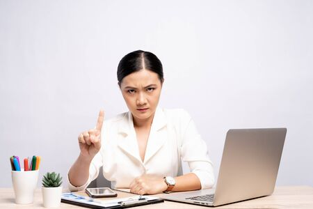Angry woman working at office isolated over background Stock Photo
