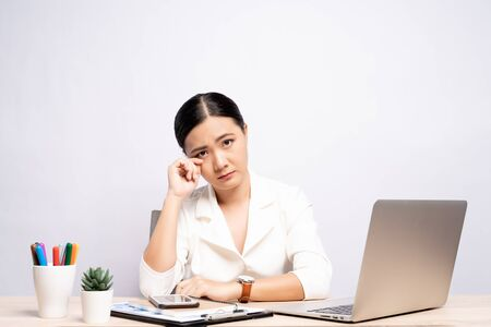 Sad woman crying at office isolated over background