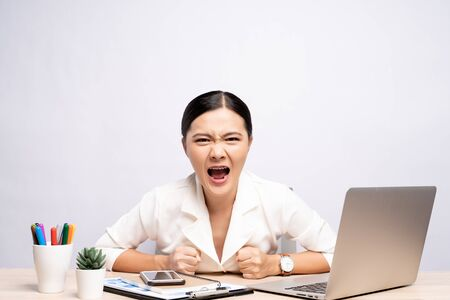 Angry woman screaming at office isolated over background 스톡 콘텐츠
