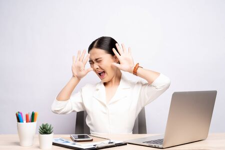 Angry woman screaming at office isolated over background Stock Photo