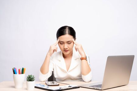 Woman has headache at office isolated over white background