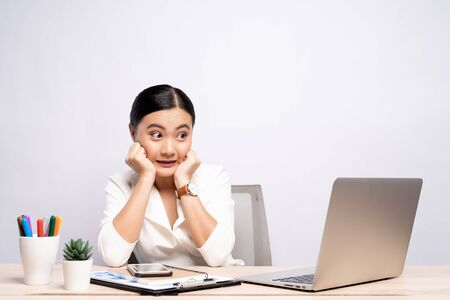 Portrait of a woman feel scared sitting at office isolated over background