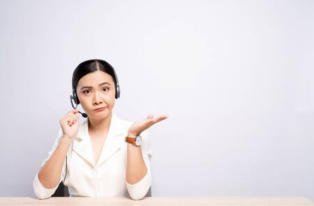 Woman operator in headset feel confuse over white background