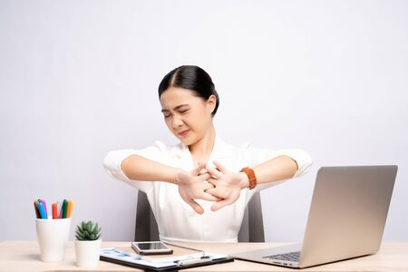 Woman has body pain isolated over white background: Office syndrome concept