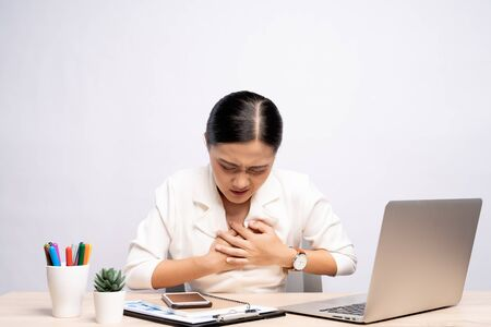 Woman has chest pain at office isolated over white background