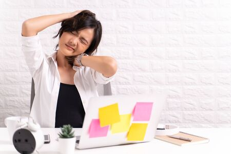 Woman has body pain at office: Office syndrome concept