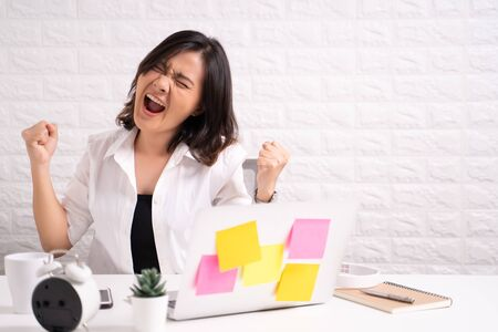 Angry woman working at office