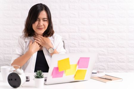 Sick woman at office with fever