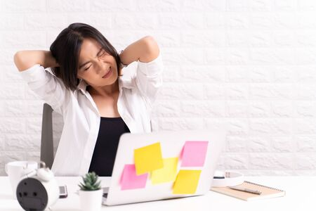 Woman has body pain at office: Office syndrome concept Archivio Fotografico - 131083992
