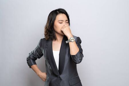 Businesswoman was sick with fever isolated over white background Stock Photo