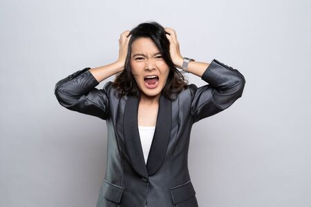 Angry woman screaming isolated over white background