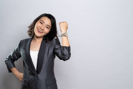 Happy woman holding hand with wrist watch