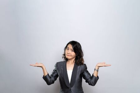 Portrait of a confused woman isolated over white background