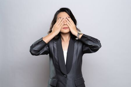 Businesswoman has eyes pain isolated over white background Stock Photo