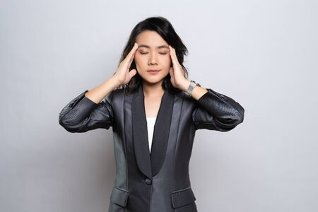 Businesswoman has headache isolated over white background