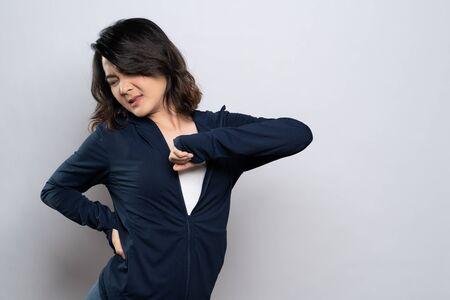 Woman has body pain isolated over white background