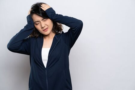 Woman has headache isolated over white background