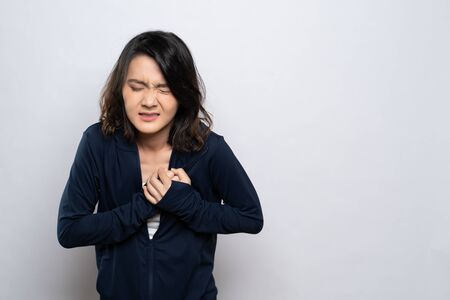 Woman has chest pain isolated over white background