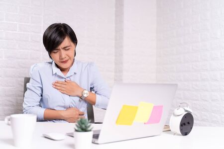 Woman has stomachache at office