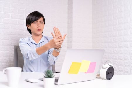 Woman has body pain at office: Office syndrome concept Stock Photo
