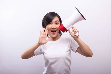 Happy woman with megaphone shouting