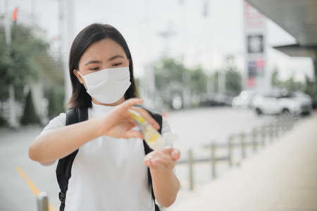 Asian woman wearing protective face mask prevention virus and pollution, coughing and standing at department store. New lifestyle with Corona Virus COVID-19. Imagens - 150874779