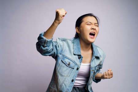Asian woman shouting isolated on white background.