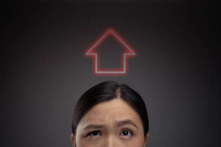 Unhappy Asian woman and red lightbulb icon hologram effect. Isolated on background.