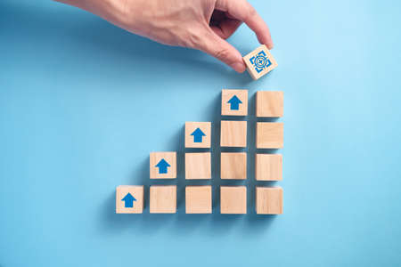 Wooden blocks staircase with arrow icon, Business planning concept.