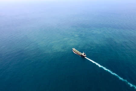 Motor tanker at oversea transport oil using their own engine full speed. Stock Photo