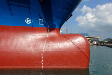 Bulbous bow section of vessel in sea water and some part of blue sky. Imagens