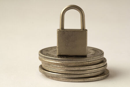 padlock on coins on the white background photo