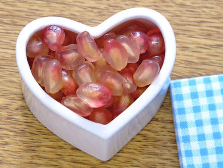 hart: Pomegranate seeds on the hart cup Stock Photo