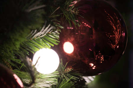 out of focus scenery of Rad Christmas balls with Abstract light colour bokeh background of blurry with space for text