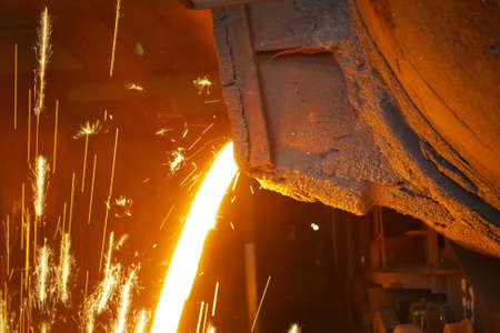 foundry: Molten hot steel is pouring - Industrial metallurgy