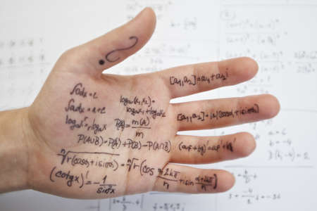 Hand of student with cheat sheet for math exam  Stock Photo - 17169931