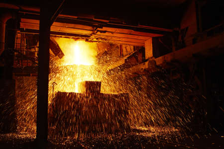 Molten hot steel is pouring - Industrial metallurgy photo