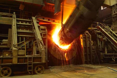 metallurgy: Molten hot steel is pouring - Industrial metallurgy