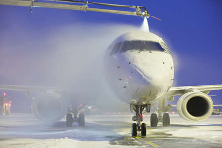 De-icing of the airplane photo