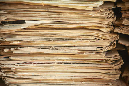 print media: Old and damaged newspapers on heap Stock Photo