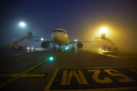 airport runway: De-icing of the airplane