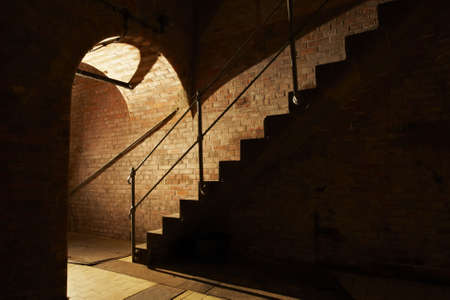 Stairs and underground corridor in old industrial building. Stock Photo